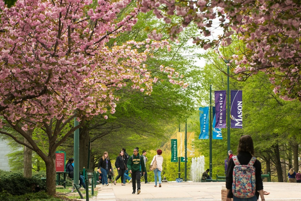 """Students walking to class on the North Plaza. Photo by Evan Cantwell/Creative Services/George Mason University"""